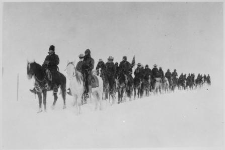 Return of casey s scouts from the fight at wounded knee 1890 91 soldiers on horseback plod through the snow nara 531103